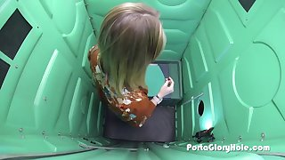 pale girl sucking cock in parking lot inside of the porta gloryhole at night time